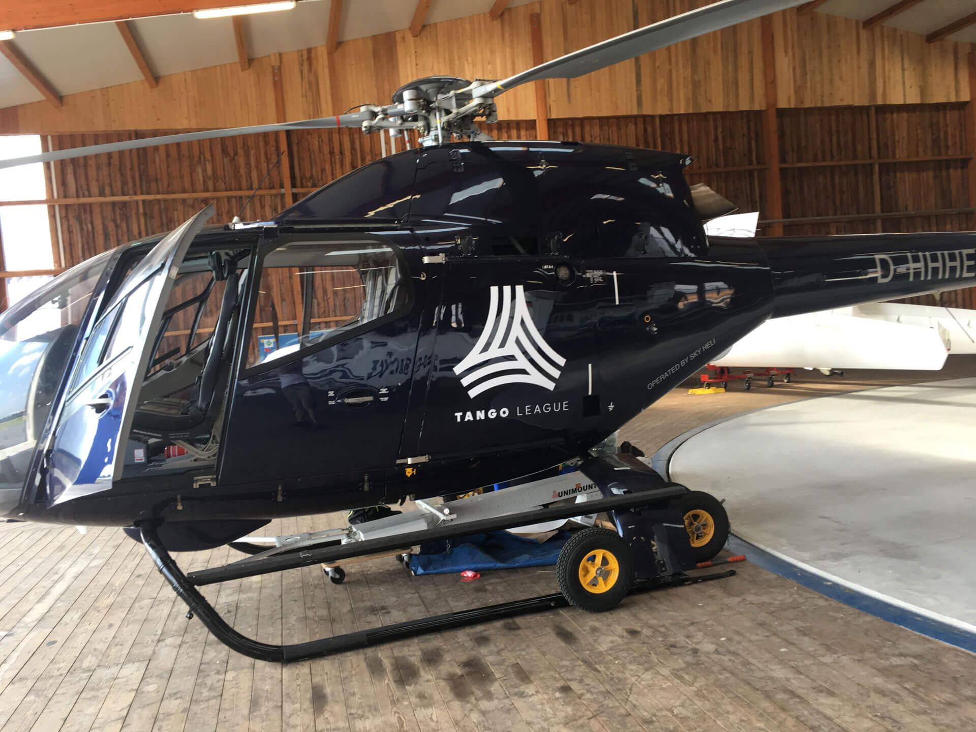 Folienpartner-Helikopter-Beschriftung-Folierung-Beklebung-Logo